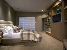 this would make a nice sanctuary - love the headboard and the sleek look of the wall unit