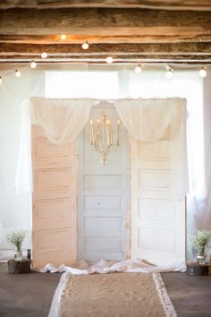 Pastel Vintage Doors as Ceremony Backdrop...idea for across the top of the doors