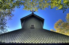 NORWEGIAN STAVKIRKE / An interesting angle of the Stave Church tower on Washington Island., Door County, WI, USA
