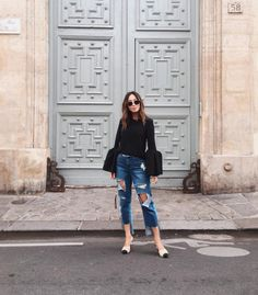 8 fall fashion outfit ideas to copy from the best blogger Instagrams of the week: Aimee Song wears ripped jeans and a bell-sleeved shirt.