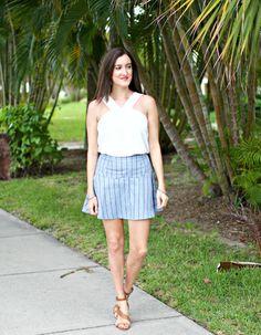Blue Pinstripe Skirt with White Sleeveless Top. Feminine summer outfit ideas for women