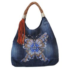 """""""Hobo Chic"""" Denim Hobo All eyes will be on you when you carry this soft slouchy denim hobo adorned with sparkling detail at front. It is hobo chic at its best. Stylish and functional at the same time, it offers 5 interior compartment and an exterior pocket with center magnetic snap closure."""