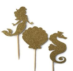 Our mermaid cake topper is cut from glitter card stock and adhered to a wooden…