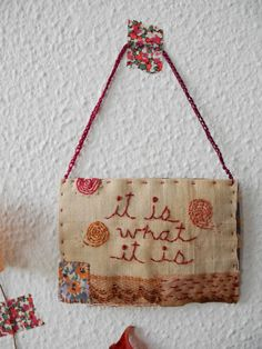 Embroidered words on rectangle fabric with ribbon by giovabrusa