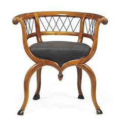 A NORTH ITALIAN POPLAR AND EBONISED ARMCHAIR   FIRST HALF 19TH CENTURY