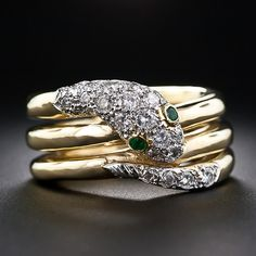 Tiffany & Co. Schlumberger Diamond Snake Ring. is sparkling diamond serpent, with emerald eyes, coils three times around your finger in this superb and substantial (weighty) snake ring with an impressive pedigree - Schlumberger and Tiffany & Company. Lang Antiques.