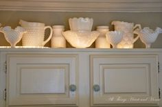 Love this for extra storage above cabinets.  Great place to store my over-sized serving dishes.  Rope lights to make it a feature.  So doing this!