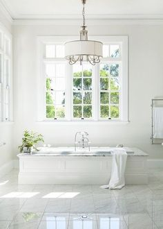 Traditional bathroom 338332990742701359 - This breathtakingly beautiful space proves that traditional fittings can create a fresh look that's neither old-fashioned nor fussy. All White Bathroom, Narrow Bathroom, Modern Bathroom, Budget Bathroom, Bathroom Ideas, White Bathrooms, Tiny Bathrooms, Bathroom Windows, Bathrooms Online