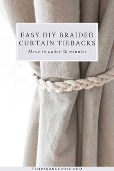 Incredibly easy DIY no-sew braided curtain tiebacks - in under 30 minutes! This post shows you how to make your own rustic, farmhouse braided curtains using a few cheap materials (jute and cotton sash). Make a whole bunch of them instead of buying premade curtain tiebacks to get farmhouse style on a budget! #diy #diyhomedecor #homedecor #curtains #farmhouse