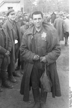 """Eastern Front, August 1941: A Soviet POW poses wearing his Star of David. Orders to all German troops stressed that Jewish POWs were to be separated from the rest and held until further instructions. In the opening phases of the invasion, there was still no clear-cut plan. Later, Jewish POWs met mostly the fate of all other Jewish deportees."""