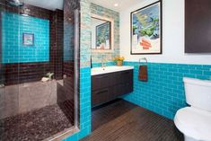 Rich, dark browns and a vibrant teal blue combine in this midcentury modern bathroom. The bathroom's striking color palette evokes thoughts of the Caribbean sea, making the space feel like a refreshing escape. Teal Bathroom Decor, Eclectic Bathroom, Brown Bathroom, Bathroom Interior Design, Modern Bathroom, Bathroom Ideas, Bath Ideas, Single Bathroom Vanity, Vanity Sink