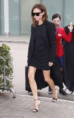 Power dressing to perfection: Victoria Beckham was impeccably clad when she touched down at Hong Kong International Airport in China on Wednesday