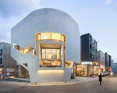 moon hoon curves concrete k-pop building in korea