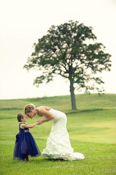 bride with adorable flower girl. Photography by Red Shoe Bride via Melissa Hearts Weddings Blog