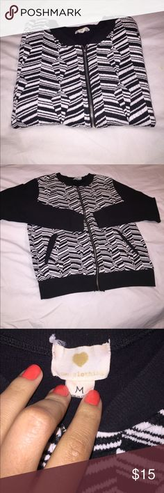 Tribal patterned cardigan Tribal black and white  patterned cardigan in the size Medium. Two pockets in the front. Worn and washed but it's in good condition. Sweaters Cardigans