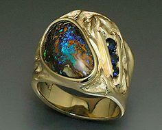 14k yellow gold, one of a kind ring with Yowah Opal and Sapphires. http://www.triosstudio.com/gallery_pages/gallery17.php