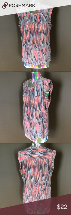 """Amber Sun Abstract Sleeveless Top Gorgeous orange & gray abstract printed top by Amber Sun. Sleeveless with curved hemline. Side zip for easy on/off. Lightweight fabric with no stretch.  63% Rayon, 37% Silk. Length: 27"""". Loose & flowy fit. This is a gorgeous top, perfect for vacation or festival season!  Gently worn, great condition! Amber Sun Tops"""