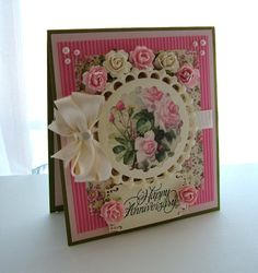"Anniversary Card, 6""x6 3/4"". Cardstock in shade of Pink, Cream & Green along with a Print Paper With Roses on it.  I also added Pink & Cream Paper Roses, Cream Ribbon & Bow & Cream Pearls."