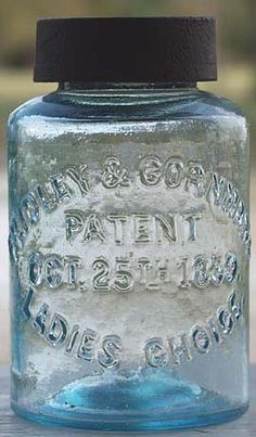 FRIDLEY & CORNMAN'S / PATENT / OCT. 25TH 1859 / LADIES CHOICE pint in aqua with original cast iron lid that has star-shaped cutout.