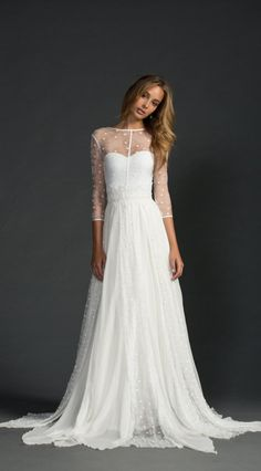 Sheer sleeves, gorgeous flowy wedding gown with illusion neckline.