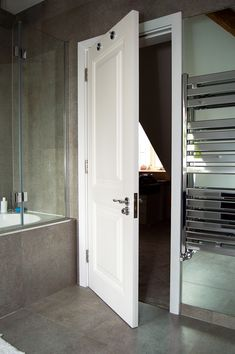 Bespoke bathroom interior door with raised door panels