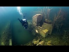 Rummu in Estonia is a former Soviet prison camp and open cast mine which naturally flooded after it was abandoned and has become a popular local dive site with good viz and strange buildings and structures to explore.