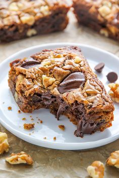Ultra thick and chewy brown butter blondies loaded with toasted walnuts and plenty of chocolate chips! They're practically begging to be served with a cold glass of milk.