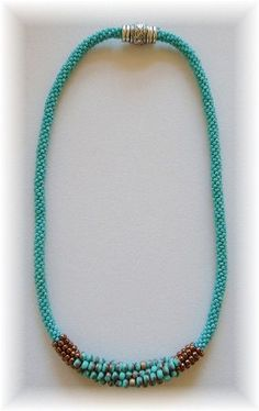 this necklace was made with size 11, 8 6 seed beads.....I LOVE it