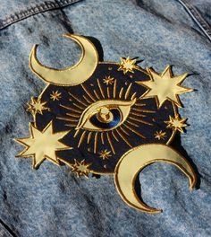 A magic moon mystic patch for customising your favourite jacket...Limited  edition run of 100 of each variant – roses or stars (select variant at  purchase).  Large embroidered patch, featuring dark navy and pale yellow twill, with  metallic gold embroidery. Designed for heavy denim or militar