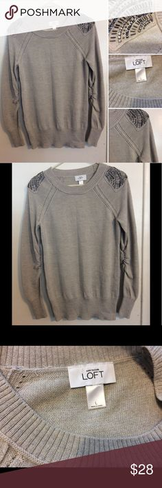 Ann Taylor LOFT sweater NWOT This gorgeous LOFT sweater is a light beige color it has eyelet detailing as well and beaded and crystal embellished shoulders. It's a size large and a wool acrylic blend. Comes from a smoke free home LOFT Sweaters