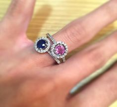Blue & Pink Sapphires surrounded by a halo of dazzling diamonds.The perfect additions to our Ella engagement ring collection. #thediamondstoreuk #engagementring #pinksapphire #bluesapphire #diamonds #ring #jewellery #diamonds