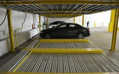 ParkPlus' semi-automated lift-slide parking system in New Jersey - http://www.telegraph.co.uk/technology/news/11884455/Would-you-let-a-robot-park-your-car.html