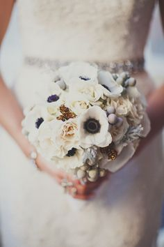 Adding dark blue to the white bouquet and a touch of grey could tie in the brides maid dresses, etc and add interest