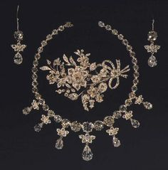 Set of brilliants consisting of necklace with seven pendants, brooch in the form of a floral bouquet, and earrings. Made in 1840 by C.M. Weisshaupt. The jewellery dates back to Queens Sophie Magdalene, Caroline Mathilde and Juliane Marie. Danish Crown Jewels.