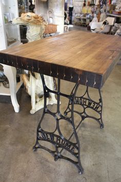 Re-purposed Antique Black Iron Pedestal with Handsome Butcher Block 'Demi-Size' Work Table. $350.00, via Etsy.