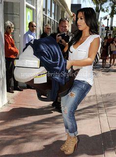 Seen on Celebrity Style Guide: Kim Kardashian arriving W/Baby Mason @ Dash Boutique 3/30/2010