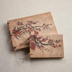 Branches abounding in cherry blossoms cloak our journals in springtime regalia. Sustainably harvested cherry wood covers
