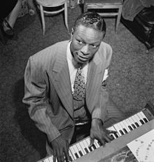 Nat King Cole, was an American musician who first came to prominence as a leading jazz pianist. He owes most of his popular musical fame to his soft baritone voice, which he used to perform in big band and jazz genres. He was one of the first black Americans to host a television variety show, and has maintained worldwide popularity since his death.