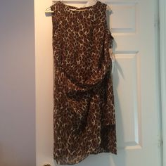 A David Warren Animal print wrap dress A David Warren Size 12 Animal print sleeveless wrap dress. New with tags. Never worn. Great condition. Comes from Smoke Free home. Asking price or best offer David Warren Dresses