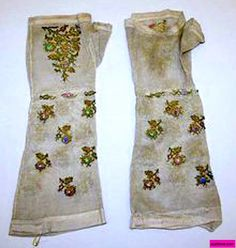 19th Century Early. Silk Mitts with floral embroidery. via suzilove.com and Metropolitan Museum New York City, U.S.A. metmuseum.org
