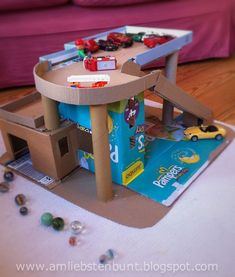 homemade baby toys More - Diy Cardboard Toys Toddler Crafts, Toddler Activities, Crafts For Kids, Cardboard Car, Cardboard Crafts, Projects For Kids, Diy For Kids, Homemade Baby Toys, Toy Garage