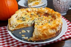 Roasted Pumpkin Quiche with Caramelized Onions, Gorgonzola and Sage. Will have to try it.