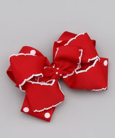 Take a look at this Red Polka Dot Moonstitch Bow Clip by Precious Treasures Bowtique on #zulily today!