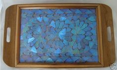 http://www.icollector.com/Handmade-Wood-Butterfly-Wing-tray_i10231089 17.50