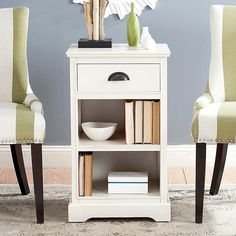 The Griffin Side Table from Safavieh is a perfect addition to your space. It features a classic country style, is crafted of pinewood and features a half-moon drawer pull. It provides ample storage space with its drawer and 2 shelves. Find Furniture, Accent Furniture, Living Room Bench, Bar Height Table, White Side Tables, End Tables With Storage, Engineered Wood, Sectional Sofa, Storage Spaces