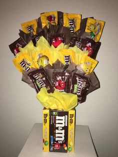 M&Ms candy bouquet Candy Boquets, Candy Bar Bouquet, Gift Bouquet, Lollipop Bouquet, Candy Birthday Cakes, Candy Cakes, Candy Gift Baskets, Candy Gifts, Raffle Baskets