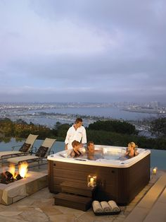 Don't let gloomy weather ruin your party; jump in a Hot Spring spa! Learn more about hot tub entertainment: http://www.hotspring.com/hot-tub-accessories/spa-entertainment-systems?utm_medium=social%2Bmedia