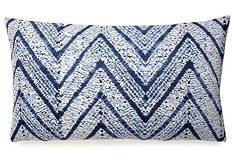 This blue and white chevron pillow pairs modern design with classic appeal.