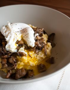 breakfast of champions: poached egg on sauteed oyster mushrooms over parmesan polenta...truffle oil drizzled on the top