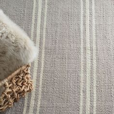 Take your grey obsession indoors or outdoors with this versatile grey and ivory striped rug! Perfect for any porch, hallway, bedroom, or patio!